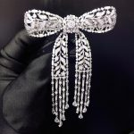 high quality 925 <b>sterling</b> <b>silver</b> with cubic zircon bowknot brooch tassels fashion women <b>jewelry</b> free shipping
