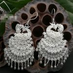S999 <b>sterling</b> <b>silver</b> original national fan wind pee ear pendant Miao hand brushing allergy