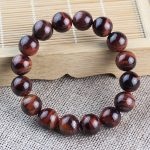 Manufacturer wholesale natural crystal <b>jewelry</b> red tiger eye stone hand chain tiger eye stone hand string men and women lover j
