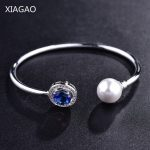 XIAGAO Famous Brand Open Bracelets Resizable Bangles for Women Silver Color Round Blue/Red Stone Top Quality <b>Jewelry</b> Gift