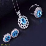 KJJEAXCMY boutique jewels 925 sterling <b>silver</b> inlaid with blue topaz ring + pendant + <b>earrings</b> necklace with <b>silver</b> color.